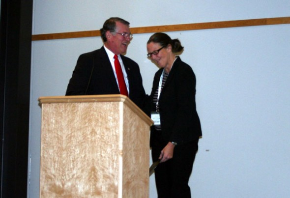 Tecumseh Land Trust Executive Director Krista Magaw accepts her award as an Ambassador to Ohio agriculture from Robert Biggs, director of the Ohio Department of Agriculture at the 11th Annual Ohio Farmland Preservation Summit last week in Columbus. (Submitted Photo)