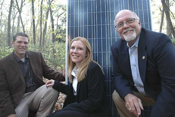 From left, Scott Lindstrom, Shannon Lindstrom and Paul Wren launched their new company, Yellow Springs Renewable Energy, at a public forum last month. The local company, here with a solar photovoltaic panel, aims to provide residential, commercial and village-scale solar power.