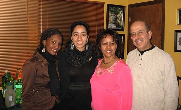 Espérance, left, a student from the Byimana School of Sciences in Rwanda, said goodbye to her host family, Savita, Saba and Vijay Bathija this week. Two students and a teacher spent three weeks in Yellow Springs, living with host families, attending school and trying activities such as skiing. They make the journey home today. (Submitted Photo)