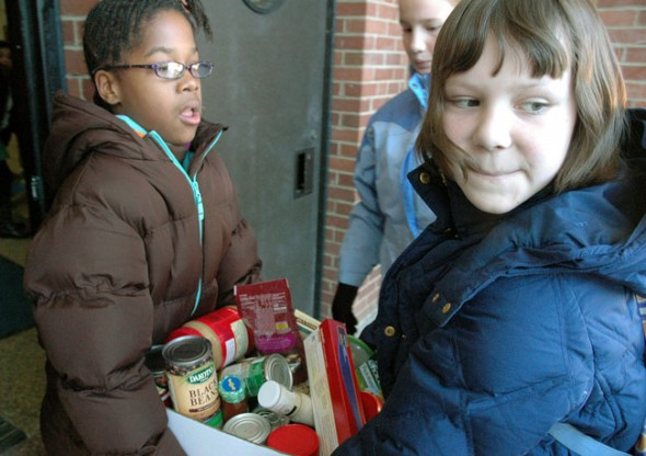 Resse Elam, left, and Aza Hurwitz shuttle food to the Methodist Church pantry