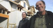 Jonathan Brown, left, and Roy Eastman are building three passive houses in the Thistle Creek development. The passive house uses a variety of energy-efficient building techniques, including double-thick walls to retain heat. (Photo by Megan Bachman)