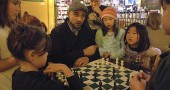 Check, mates!— Omar Durrani coached local chess enthusiasts on the smart moves at the Emporium last Sunday over a game between Amelie Maruyama, left, and Olivia Ling. Observing and trying so hard not to give away the answers were from left, Zenya Miyazaki, Jacob Woodburn, Eliana Ling and Kai Maruyama. (Photo by Lauren Heaton)