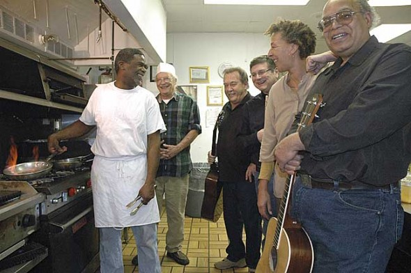 "The local band Mack and the Rockets will perform this Friday, Jan. 21, at a ""rent party"" for CJ's restaurant, which is having financial problems. The event, which takes place from 6 p.m. until closing at the restaurant, will feature a special Cajun menu. Pictured are, from left, restaurant owners Carl Moore and Jim Zehner and band members, from left, Ed Campbell, L.B. Fred, Ona Harshaw and Mark Crockett. Not pictured are band members Lori Askeland and Allen Knisley. (Photo by Diane Chiddister)"