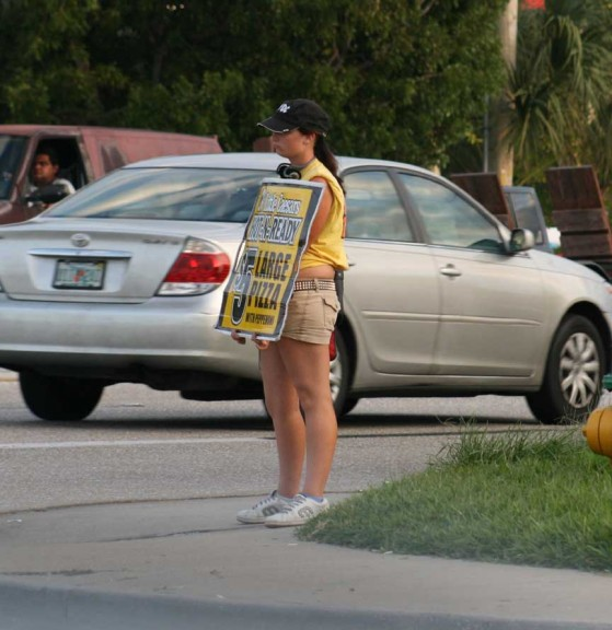 Pizza is a notable exception to the common aversion to purchasing things advertised on cardboard signs by the road. (Photo by Willie Lunchmeat)
