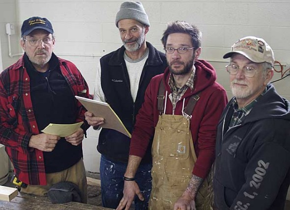 A group of volunteers from Yellow Springs and beyond has begun working to restore the Antioch College campus. Called VAMP — Volunteers for Antioch Maintenance Projects — the group recently turned the former Maples fire station into a central working space. Shown above are, from left, Jonathan Zimmerman, Jim Spangler, Joshua Miller and Jon Baker. (Photo by Sehvilla Mann)