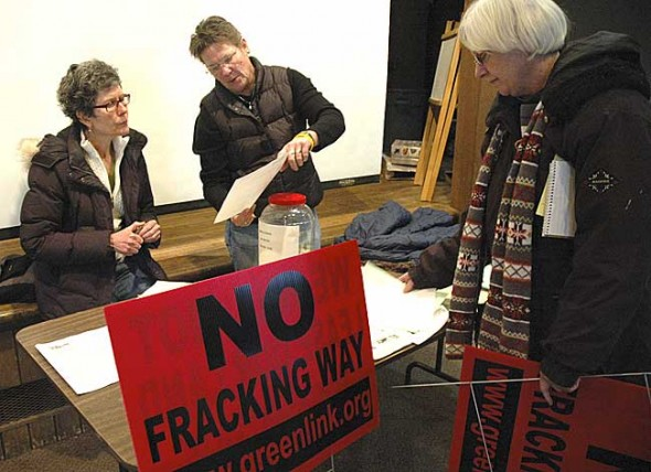 At a public meeting on oil and gas drilling, Vickie Hennessy of Green Environmental Coalition explained to Maureen Dawn how to educate her neighbors on the dangers of hydraulic fracking. (Photo by Megan Bachman)