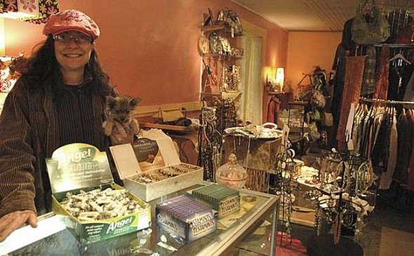 Donna Blackman, here with her dog Rosey, opened Heaven On Earth Emporium earlier this month. The store features a variety of new and antique products, such as ladies apparel, jewelry, chocolate and soap. (Photo by Megan Bachman)