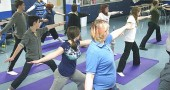 This month local yoga instructors Jen Ater, above, top right, and Gail Lichtenfels launched a program to teach yoga in village public schools. Shown above are McKinney Middle School students at a yoga class this week. (Photo by Sehvilla Mann)