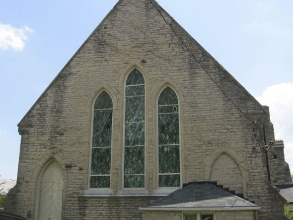 The church hopes to restore the original diamond-shaped green stained-glass windows facing Walnut Street. The windows are currently covered by drywall. (Submitted photo)