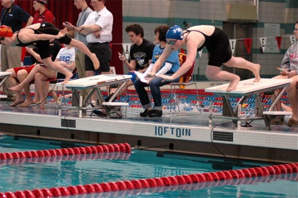 Elizabeth Malone dives from the platform at the start of the 200-yard individual medley.