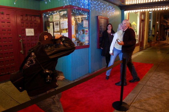Paparazzo Matt Minde pesters the crowd at the Little Art Theater's Oscar fundraiser (photo by Aaron Zaremsky)