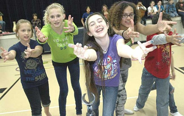 Join a singing, dancing Kaa and his coils, played by, from left, Grace Wilke, Olivia Chick, Kallyn Buckenmyer, Shekinah Williams, David Walker and Kayla Brown (obscured) this weekend as Mills Lawn School presents Bollywood Jungle Book, the all school musical, at Central State's Robeson auditorium. Shows are Saturday, March 5, at 7 p.m. and Sunday, March 6, at 2 p.m. Tickets are on sale now at the school. (Photo by Lauren Heaton)