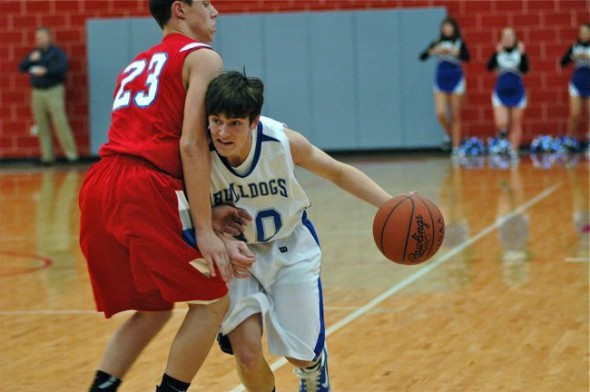 Haller charges past a Tri-Village player on his way to the hoop. Haller had nine points in the team's 62–43 loss.