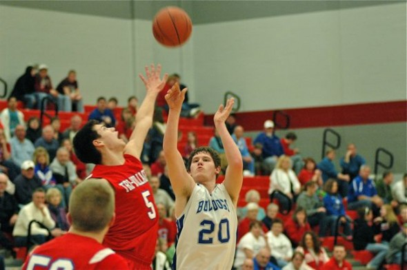 Cole Edwards shoots over a jumping Tri-Village player to drop an eight-footer.