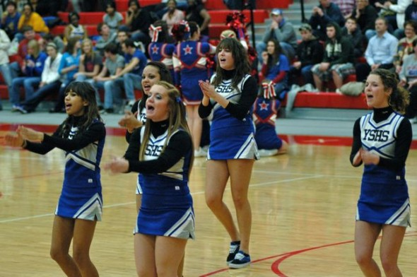 The Yellow Springs cheerleading squad fires up the crowd.
