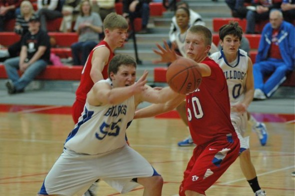Massie reaches for a pass while a Tri-Village defender challenges for the ball.