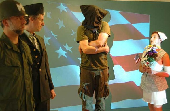 From left, Kiefer Erdmann, Skip Leeds, Brendan Sheehan and Melissa Heston act out the story of Eddie Slovik, the American soldier executed for desertion in World War II. (Photo by Megan Bachman)