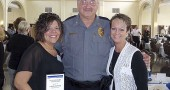 "Yellow Springs Police Officer Naomi Penrod was honored April 28 for her work with abused and neglected children. She received a ""Child Advocate of the Year"" award from Greene County Children Services. She's shown at the awards breakfast with Yellow Springs Police Chief John Grote and Village Administrative Assistant Ruthe Ann Lillich. (Submitted photo)"