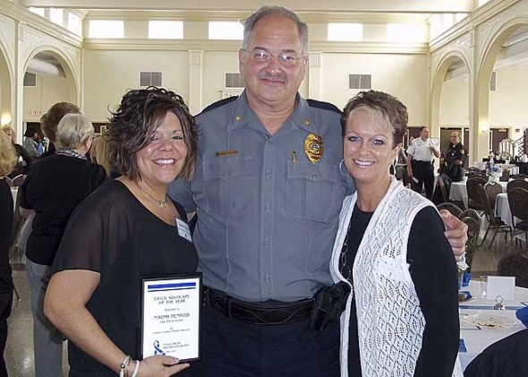 """Yellow Springs Police Officer Naomi Penrod was honored April 28 for her work with abused and neglected children. She received a """"Child Advocate of the Year"""" award from Greene County Children Services. She's shown at the awards breakfast with Yellow Springs Police Chief John Grote and Village Administrative Assistant Ruthe Ann Lillich. (Submitted photo)"""