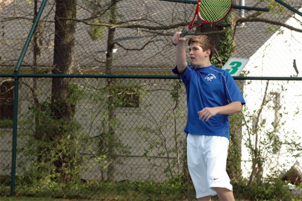 Isaac Haller returned a serve in the first-doubles victory.