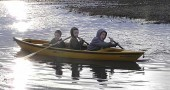 From left, Will, Noah and Logan Spracklen canoed across a flooded farm field earlier this week at the family's Green Township home, where in a normal year the corn would already be several inches high. (Submitted photo)