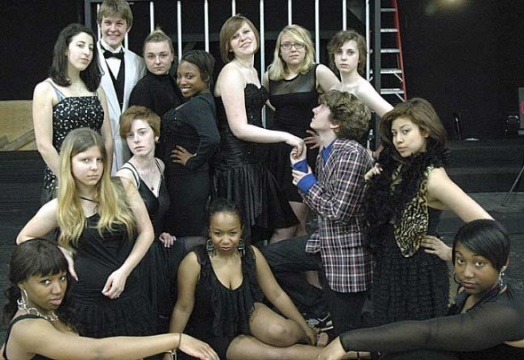The Yellow Springs High School drama club will open its spring musical, Chicago, this weekend at the Mills Lawn Auditorium, with performances on Friday and Saturday at 8 p.m. and on Sunday at 2 p.m. Senior cast members are, in the back row, from left to right, Liana Rothman, Elliot Cromer, Anne Weigand, Malaika Halley, Lauren Westendorf, Lydia Jewett and Emma Holman-Smith; middle row, Julia Tucheslau, Miranda Russell, Adam Zaremsky and Bella Hernandez; front row, Natasha Perry, Zyna Bakari and Stephanie Scott. (Photo by Megan Bachman)