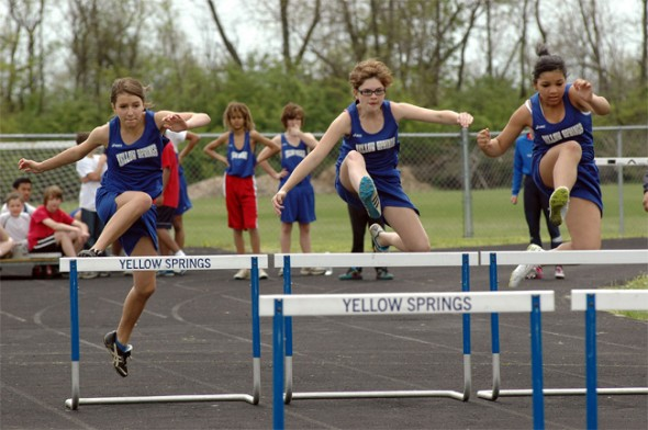 From left, Ashlyn Burch, Rhona Marion and Ashley Longshaw competed in the 100-meter hurdles. Marion won the race in 19.45 seconds.
