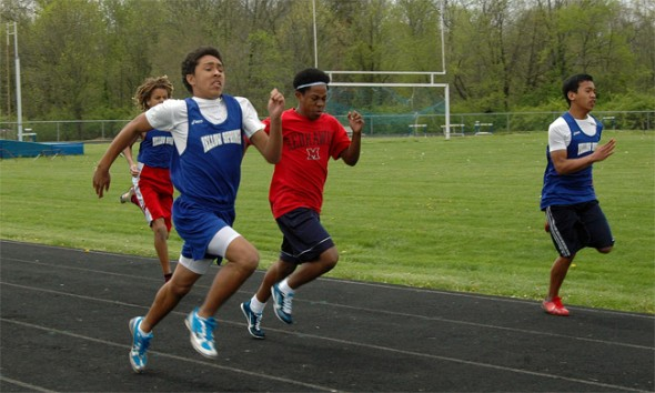 Edward Johnson charges out to the front of the pack in the 100-meter dash, with (from left) Oluka Okia, Bryce White and Matt Conner behind.
