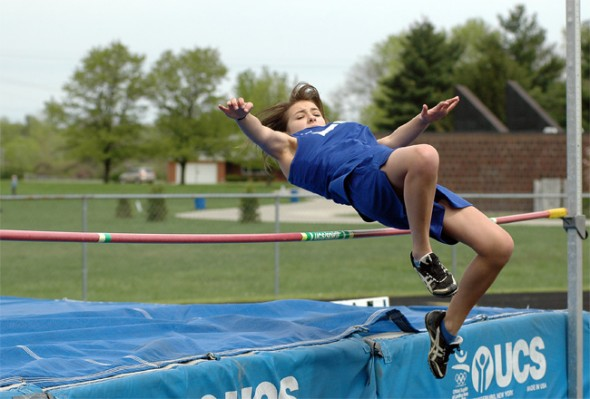 Ashlyn Burch arches over the high jump in the girls competition.