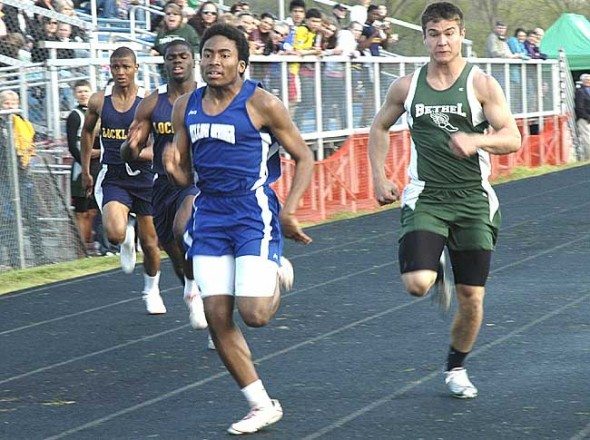 Senior Mario Cosey sprinted to second place in the 100-meter dash at regionals last weekend, propelling him to his second state appearance. Here Cosey wins last month's Bulldog Invitational. (Photo by Lauren Heaton)