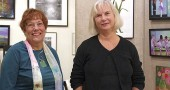 Gayle Sultzbach (left) and Christine Klinger opened Springs Gallery in Kings Yard this spring, featuring art by local and regional artists, as well as some of their own work. (Photo by Sehvilla Mann)