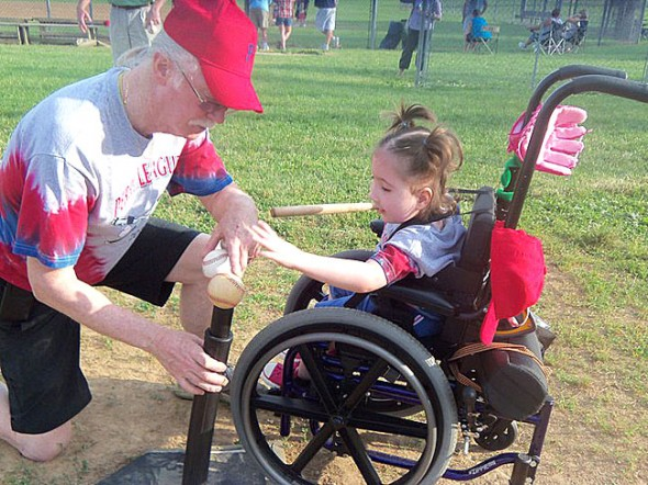 Jimmy Chesire got down in the dirt with t-ball player Mia Campbell at Gaunt Park on Friday, June 17. (Submitted photo)