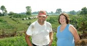 Dairy farmer Jim Semler and Tecumseh Land Trust associate director Michele Burns celebrated the closing of an easement on the 171-acre Semler farm on Snypp Road, one mile west of Yellow Springs. The farm, which contains the headwaters of the Jacoby Creek, is the first property in the Jacoby Greenbelt preserved with Village funds.