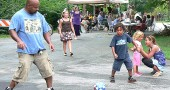 Kids and grown-ups alike appeared to enjoy themselves at one of last year's 19 neighborhood block parties, sponsored by the Human Relations Commission. This year's block parties take place the week-end of Aug. 19–21, with most on Sunday, Aug. 21, 5–8 p.m. Check the accompanying article for the list of the neighborhoods having parties, and if you wish to host one in your neighborhood, contact Joan Chappelle at 767-7056. (Submitted photo by Susan Gartner)