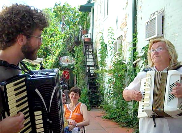 Ben Hemendinger and Birkásné Sej Edit trade accordion tunes on a Friday afternoon by the Emporium in Yellow Springs, OH.