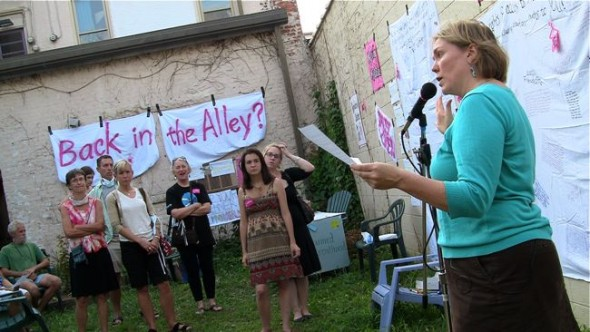 Organizer Lori Askeland laid out Ohio's legislative attempts to restrict women's reproductive choice at a rally on Friday. (Photo by Megan Bachman)