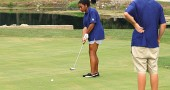 YSHS freshman Taylor Beck putted for bogey at the par three second hole at Locust Hills Golf Course in Springfield last week, while teammate Liam Weigand cheered her on. Beck scored 66 over nine holes as the YSHS golf team (1–2) lost the match to Dayton Christian 209–170. (Photo by Megan Bachman)