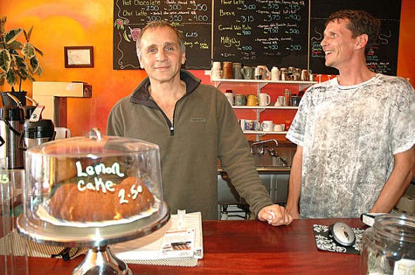 Brother Bear's Coffeehouse regular Michael Herington, left, purchased the coffee shop from Patrick and Mindy Harney last month. The new Dancing Goats Cafe will still serve Brother Bear's coffee in a more comfortable, classy space. Herington is shown here with barista Shawn Butts. (Photo by Megan Bachman)