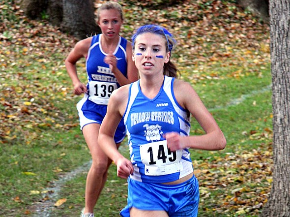 Alex Brown leads Xenia Christian's Sarah Kensinger at Middletown Christian at the league championships for cross country. Brown went on to finish sixth overall and join Lois Miller on the Metro Buckeye Conference All League Team. Miller was 2nd overall as the duo led the Bulldogs to the runner-up position in the team standings at the conference championship. Xenia Christian topped the Lady Dawgs 21 to 34. (Submitted photo by Vince Peters)