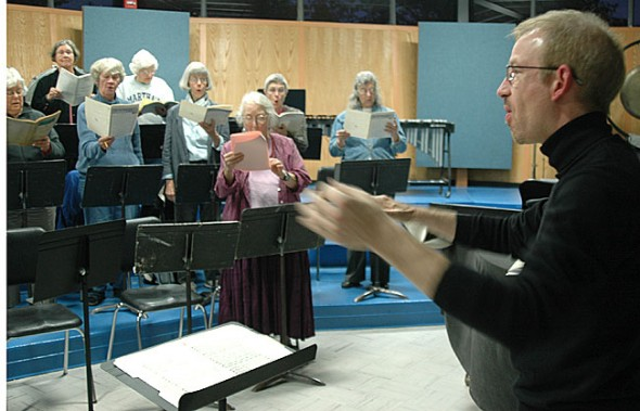 "At a recent rehearsal, James Johnston led the Yellow Springs Community Chorus in ""It Is An Illusion You Were Ever Free,"" a piece that the chorus will premier with professional piano trio Triple Helix from Wellesley, Mass. on Saturday, Nov. 5. The Yellow Springs Chamber Orchestra will perform two Beethoven pieces with Triple Helix that evening. (Photo by Megan Bachman)"