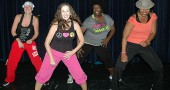 Zumba instructors Melissa Vanzant, Melissa Beard-Blair, Alisia Smith and Aurelia Blake got their groove on at a recent class. The four instructors will lead Latin-inspired dances during a two-hour Zumbathon at 7:30 p.m. on Friday, Nov. 11, with proceeds going to the McKinney School Power of the Pen creative writing team that Blake coaches. (Photo by Megan Bachman)