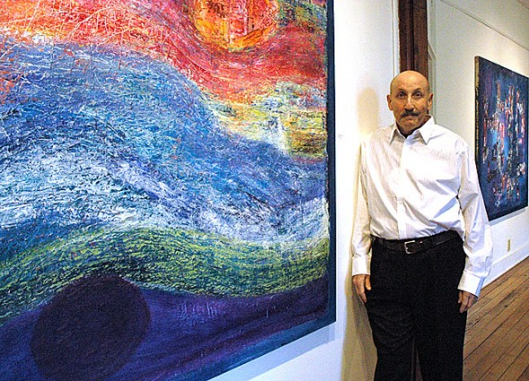 Local artist Ira Brukner is currently showing 17 of his brightly-colored, abstract paintings at a solo exhibit at the Miller Center for Visual Arts at Urbana University. The exhibit is open to the public Thursday and Saturday afternoons from 1–4 p.m. through Dec. 3, excluding Thanksgiving weekend. (Photo by Diane Chiddister)