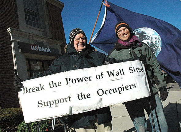 Village resident Eric Wolf, right, organized an Occupy protest in Yellow Springs last Friday in front of US Bank on Xenia Avenue to criticize the bank's practices. Bill Houston, left, was one of the 34 local people who raised their voice with Wolf to draw attention to wealth disparity and economic injustice in the U.S. (Photo by Megan Bachman)