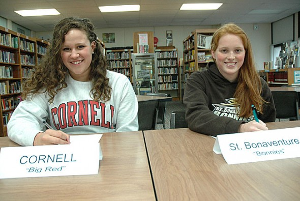 Erica Chick, left, and Elizabeth Malone are stand-out Yellow Springs High School swimmers who recently signed commitments to colleges. (Photo by Megan Bachman)
