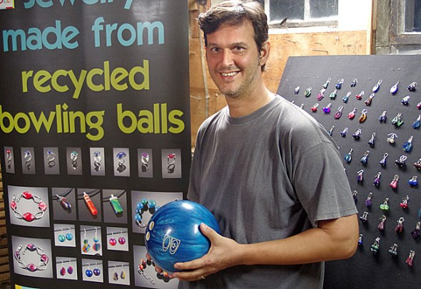 New village resident Matt Cole makes jewelry from bowling balls, and sells his work at craft fairs. He and his family moved here recently from Bali. (Photo by Sehvilla Mann)