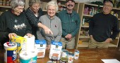 Food pantry volunteers Jean Shook, Patti McAllister, Jackie Hammond, Don Rudolf and Don Fulton put away donated items this week at the Yellow Springs Community Food Pantry in the basement of the Methodist Church. Demand for food and household goods at the pantry rises during th holiday season, and so do community donations. (Photo by Megan Bachman)