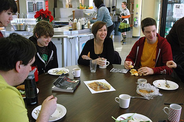 Antioch College students recently ate lunch in their cafeteria, which serves mostly non-processed food increasingly sourced from the campus farm. The Antioch experience so far has been stressful but rewarding, said students, who have to go to class, do homework, work on campus, govern themselves and cook for one another on weekends. At the table are, from left, Eros, Eva Erickson, Jennifer Carlson and Elijah Blanton. (By Megan Bachman)