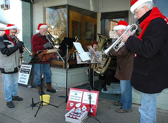 The Yellow Springs Brass! will perform tonight, Dec. 19, at 6:30 p.m. at the Friends Care Center. They are shown here performing downtown during last week-end's Holiday Fest.