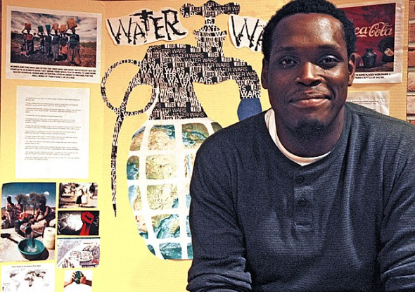 Antioch College student Adam Abraham researched the history of global conflicts caused by the scarcity of water as his final project for the global seminar on the topic of water. All 35 students presented their final projects at McGregor Hall last Wednesday. (Photo by Lauren Heaton)