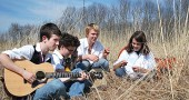 Wheels members Rory Papania, left and Sam Salazar, second from left, met at Friends Music Camp in 2009. Now the band, which also includes Friends Music Camp alums Jamie Scott and Sam Crawford, right, along with Connor Stratton (not pictured), will perform at a benefit concert for Friends Music Camp's scholarship fund on Friday, Dec. 30, at 7:30 p.m. at the Yellow Springs Senior Center. (Submitted photo by Savanah Amos)